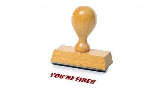yo're fired printed in red ink with wooden Rubber stamp isolated on white background